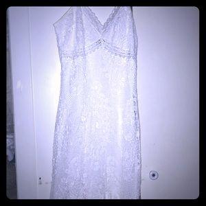I'm selling a white lace dress